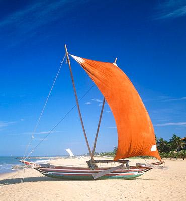 Sailboat on Negombo beach in Sri Lanka